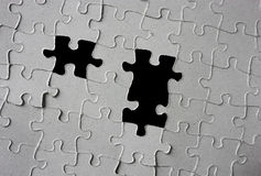 Puzzle with pieces missing Stock Photo