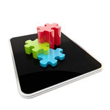 Puzzle pieces on mobile pad screen Royalty Free Stock Photo
