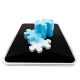 Puzzle pieces on mobile pad screen Stock Photography