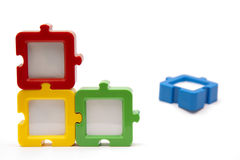 Puzzle Pieces Out. Puzzle photo frames in a square arrangement, in various colors, and isolated on white background Stock Photo