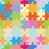 Puzzle Pieces Pattern. Colorful interlocking puzzle pieces with repeating wallpaper design Royalty Free Stock Photography