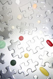 Puzzle Pieces and Pills Royalty Free Stock Photos