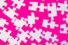 Puzzle Pieces On Pink Stock Photo
