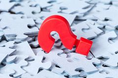 Puzzle pieces and question mark. Set goals, tasks and ways of their solution and implementation stock image