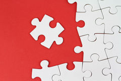 Puzzle pieces on red background Royalty Free Stock Photo