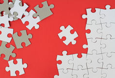 Puzzle pieces on red background Stock Photo
