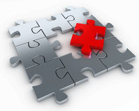 Puzzle pieces, with a red piece free Royalty Free Stock Image