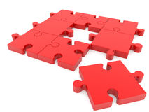 Puzzle pieces in red on white colors Royalty Free Stock Photos