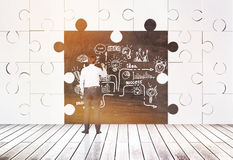 Puzzle pieces room and businessman with chalk Royalty Free Stock Photos