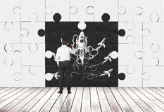 Puzzle pieces room and businessman Royalty Free Stock Image