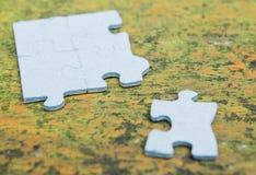 Puzzle pieces. Some puzzle pieces of paper Stock Images