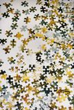Puzzle pieces spread out on table. Royalty Free Stock Images