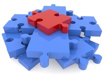 Puzzle pieces stacked on white with red one on top Stock Image