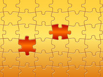 Puzzle pieces standing out. Jigsaw puzzles with two pieces standing out. It is a conceptual design Royalty Free Stock Photo