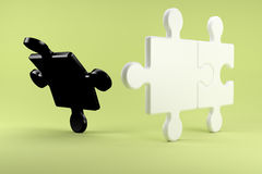 Puzzle pieces symbolize the divorce between two people Stock Image