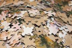 Puzzle. Pieces on a table Royalty Free Stock Image