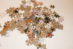 Puzzle. Pieces on a table Stock Photography
