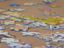 Puzzle pieces on table royalty free stock images