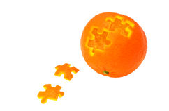 Puzzle pieces of tangerine Stock Images