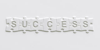 Puzzle pieces with text written on them Stock Photos