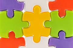 Puzzle pieces together. Nine colorful puzzle pieces together royalty free stock photos