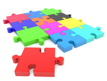 Puzzle pieces in various colors with one missing red Stock Images
