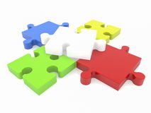 Puzzle pieces in various colors on white Stock Photos