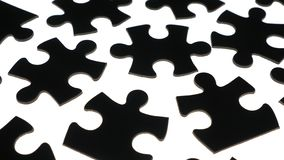 Puzzle pieces on white surface stock footage