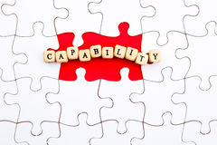 Puzzle Pieces - with word Capability in missing space. Puzzle Pieces - with words Capability in missing red space royalty free stock photos