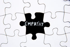 Puzzle Pieces - with word Empathy in missing space Royalty Free Stock Photo
