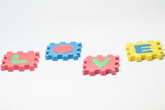 Puzzle pieces with word love Stock Photography