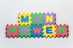 Puzzle pieces with word manpower Stock Photos