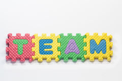 Puzzle pieces with word team Royalty Free Stock Image