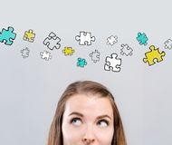 Puzzle pieces with young woman royalty free stock images