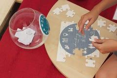 puzzle pieganti Fotografie Stock Libere da Diritti