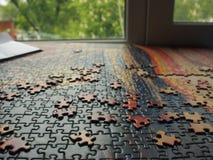 Puzzle piegato dai lotti dei dettagli Fotografia Stock