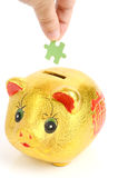 Puzzle and piggy bank Royalty Free Stock Photography