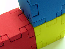Puzzle - primary colour. 3 cube puzzle in primary color Stock Photos