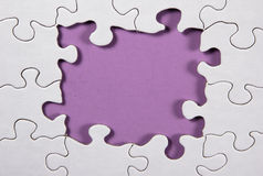 Puzzle With Purple Background Stock Photography