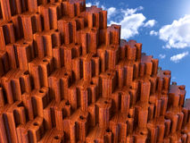 Puzzle pyramid. A pyramid of wood puzzle dowels with a blue sky as background stock photography
