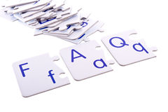 Puzzle questions. Frequently asked questions (FAQ) abbreviation in a form of puzzle letters isolated on white stock image