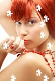 Puzzle of redhead with red beads looking over Royalty Free Stock Images