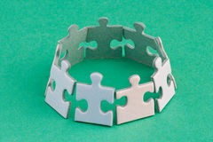 Puzzle ring. A group of small upright jigsaw puzzle pieces Royalty Free Stock Image