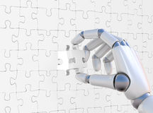 Puzzle in robohand Royalty Free Stock Photography