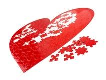 Puzzle rossi del cuore Fotografia Stock