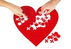 Puzzle rossi del cuore immagine stock