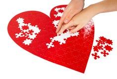 Puzzle rossi del cuore Fotografie Stock Libere da Diritti