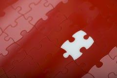 Puzzle rouge Images libres de droits