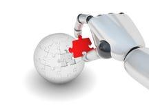 Puzzle rouge dans la main de robo Photographie stock libre de droits