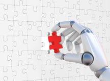 Puzzle rouge dans le robohand Photo stock